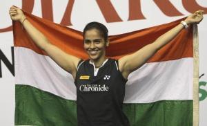 Saina Nehwal of India holds national flag